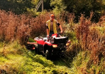 Commercial Landscape Contractor Clearing Grass
